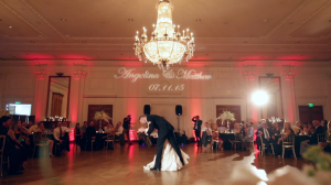 Bride and Groom dancing in Ballroom under Chandelier during Wedding Reception