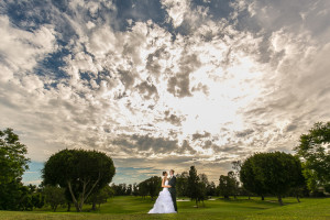 Bride and Groom on Golf Course under Big Sky
