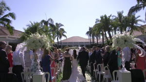 Bride walking down Aisle during Rose Garden Ceremony