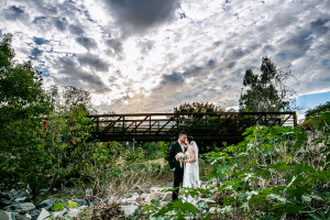 Bride and Groom pose under Bridge during Romantic Photoshoot