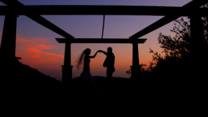 Bride and Groom dancing during sunset at Serendipity Garden Weddings in Yucaipa