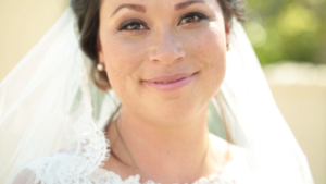 Wedding Highlight Videographer has Bride smile for the camera in San Juan Capistrano