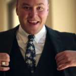 Groom smiles in Highlight Video before his Wedding Ceremony in San Juan Capistrano