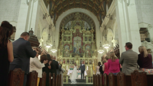 Bride and Groom standing on alter during Catholic Wedding Ceremony at St. Vincent De Paul in Los Angeles