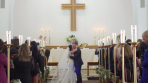 Bride and Groom First Kiss at Alter in Wedding Highlight Film in San Juan Capistrano