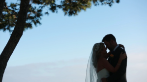 Silohuette of Bride and Groom on Malibu Bluffs at Wayfarers Chapel