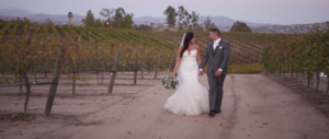 Bride and Groom walking in vineyard at Temcula Winery Wedding venue Villa de Amore