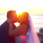 Bride and Groom kissing in front of Sunset during Wedding Highlight Film at Casa Romantica in San Clemente
